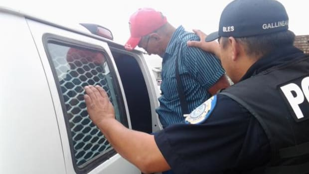 Tribal elder is arrested during Blackfeet protest of tribal government's misuse of federal funds.