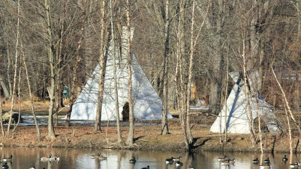 Photo of Ramapough Lenape Nation camp across the Ramapo River