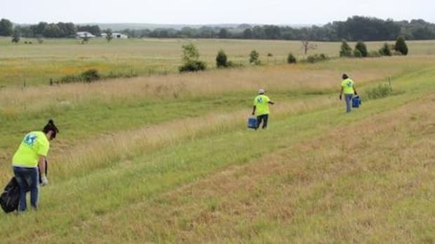 Cherokee Casino Fort Gibson employee volunteers clear trash and debris from alongside State Highway 62.