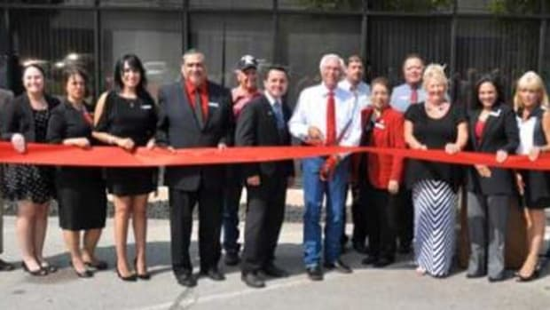 Cherokee Nation Principal Chief Bill John Baker and the Career Services team cut the ribbon on the team's new Tulsa office, with Jim Igaria of the Tulsa Regional Chamber of Commerce (front left) and Tribal Councilor Curtis Snell (back left).