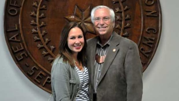 Cherokee Nation citizen Sarah Ferrell was congratulated by Principal Chief Bill John Baker for being recognized as one of 10 All Native American High School Academic Team members for 2014-15.