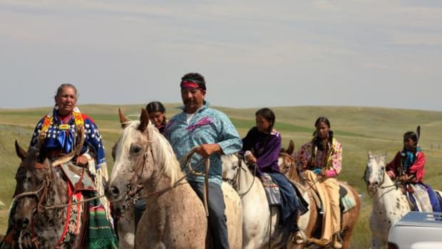 Donna Henry and Francisco Chaires (front) are seen here with young Nez Perce girls from Lawpwai.
