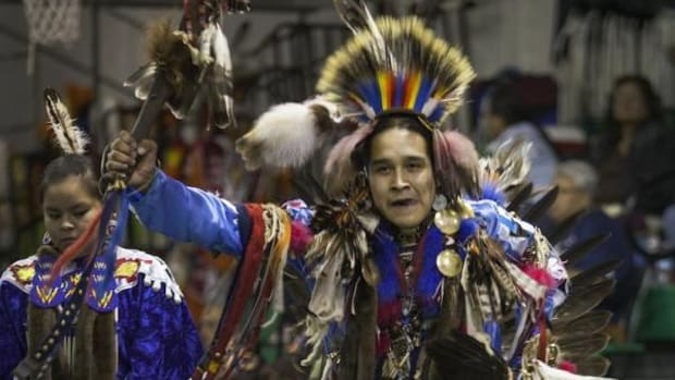 Northern traditional dancer Jared Brown of Sawmill, Ariz. dances during an inter-tribal on Saturday night, December 14, in Gallup, New Mexico, during the 2nd Annual Toys for Tots Christmas Powwow.
