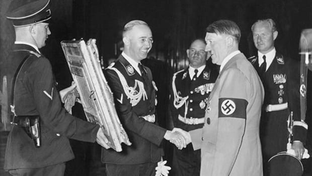 Adolf Hitler receives a painting as a birthday gift from Heinrich Himmler, 1939.