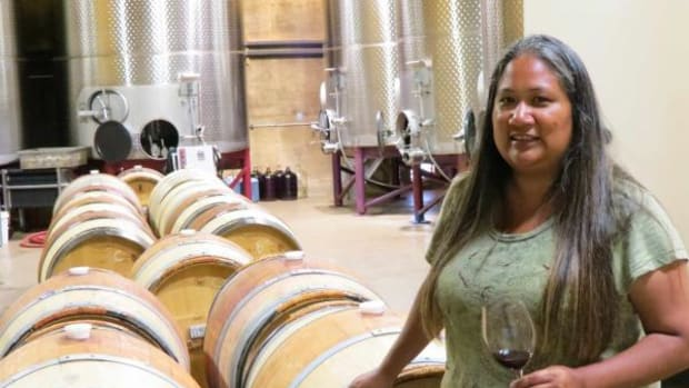 Tara Gomez, 39, tastes wines still aging in oak casks in the cellar of California's Santa Ynez Band of Chumash Indians. She is the first Native winemaker with a degree in enology to manage both the vineyard and the winemaking components of a wine business. (By Lisa Garrigues)