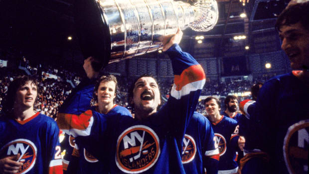 Bryan Trottier holding up the Stanley Cup after winning the NHL championship with the NY Islanders.
