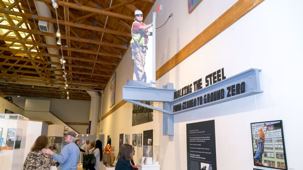 An ironworker standing on a steel beam. An exhibit at the Iroquois Indian Museum highlighting Iroquois ironworkers. Alex Hamer