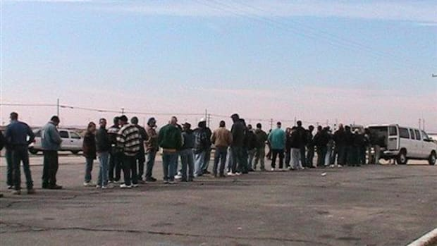 In this Sunday, January 31, 2010 file photo, mine workers stand near the entrance to Rio Tinto Borax mine in Boron, Calif. waiting for news of the lockout. Rio Tinto has been accused of labor and indigenous-rights violations worldwide.