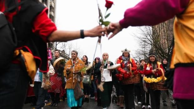 Carrying red roses for the dead and yellow for the missing, thousands marched through Vancouver's Downtown Eastside to end violence against aboriginal women in Canada.