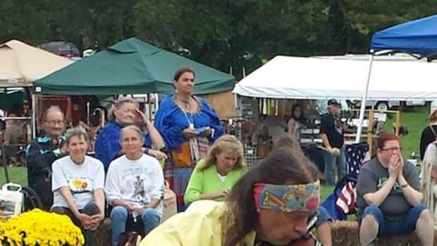 Arvel Bird, a Native American Music Award winner, performs for an audience.