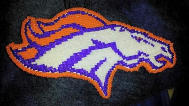 Lilah Sandoval, Diné, beaded this Bronco medallion. Sandoval was born and raised in Denver, and said a large number of Native Americans in Denver are Broncos fans.