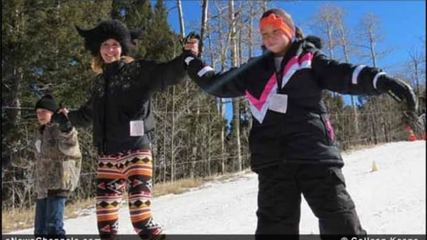 "Olympian Suzy ""Chapstick"" Chaffee (middle) teaches Jason and Jayla Abeyta (Ohkey Owingeh/San Juan Pueblo) how to joyfully fly like eagles on skis down Pajarito Mountain."