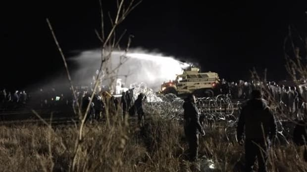 Water protectors stand off against militarized police who doused them in water cannons in 20-degree temperatures.