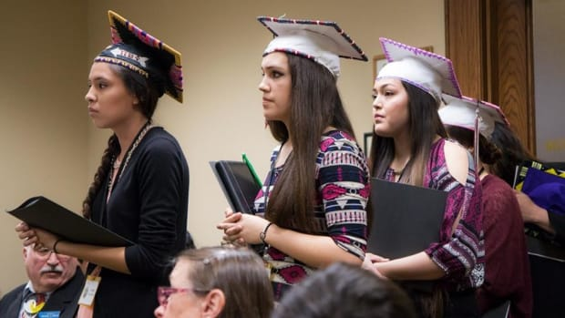 """Native American students show that their """"Culture is Not a Distraction,"""" a popular meme using images of students in graduation caps and regalia. Montana recently passed a bill allowing students to wear eagle feathers and regalia at graduation ceremonies."""