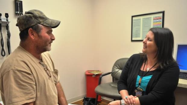 Cherokee Nation citizen James Martins, of Afton, talks with Northeastern Tribal Health System CEO and fellow Cherokee, Kim Chuculate, during a regular visit to the clinic.
