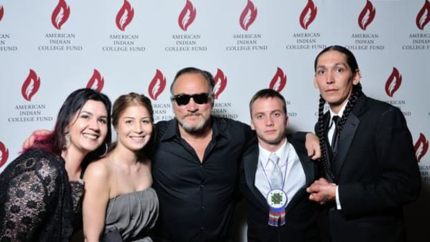 Some of the student ambassadors from the College of Menominee Nation post with Jim Belushi before the gala event in Chicago. Pictured, from left, are Sabrina Hemken, Miranda Perez, Jim Belushi, Eric Nacotee, and Brian Grignon.