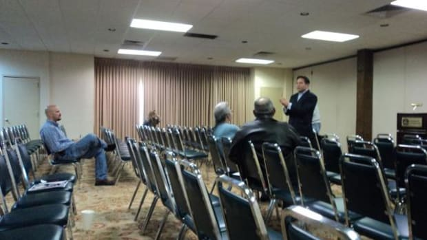 At a sparsely attended meeting in Lawton, Oklahoma hosted by attorneys for the Cobell litigation team, attorney, Keith Harper, explains settlment provisions to attendees on March 14. The Cobell attorneys traveled across Oklahoma March 14 to 16 for the notification provision outlined by the $3.4 billion trust settlement.