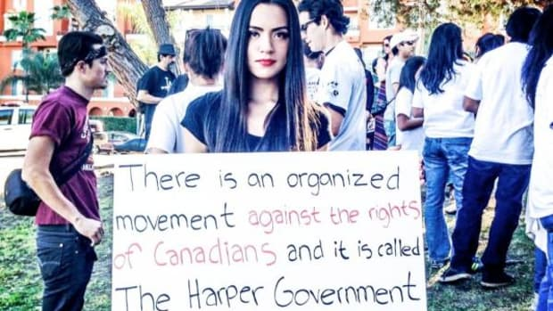 Model and actress Shannon Baker at the Idle No More rally in Los Angeles. Her sign reads 'There is an organized movement against the rights of Canadians and it is called The Harper Government #idlenomore'