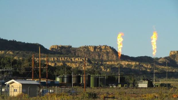 Flaring fracking rigs stand out in what was once a sweeping landscape on the Navajo Nation.