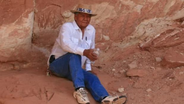 Norman Stevens pauses in a side canyon of the Paria River after showing clients Anasazi pictographs, petroglyphs and metates. (Courtesy Ron Macdonald)