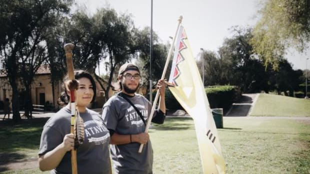 Tataviam tribal citizens holding the tribal flag welcomed the Walk for the Ancestors group at Mission San Fernando.