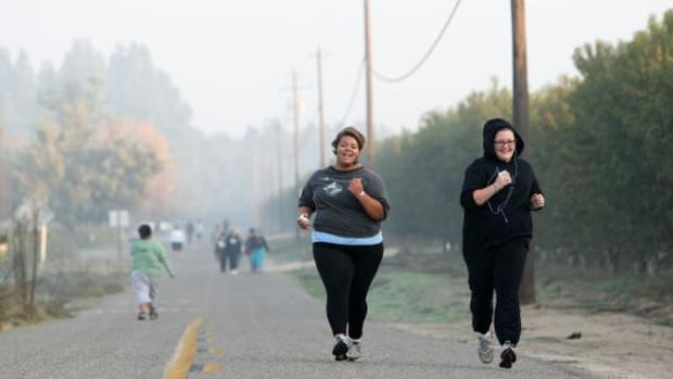 Seventeen year-old Marissa Hamilton (left) and her friend Mary Healy sprint during a timed one-mile run during fitness training at Wellspring Academy October 21, 2009 in Reedley, California. Struggling with her weight, 17-year-old Marissa Hamilton enrolled at the Wellspring Academy, a special school that helps teens and college level students lose weight along with academic courses. When Marissa first started her semester at Wellspring she weighed in at 340 pounds and has since dropped over 40 pounds of weight in the first two months of the program. According to the Centers for Disease Control and Prevention, 16 percent of children in the U.S. ages 6-19 years are overweight or obese, three times the amount since 1980.