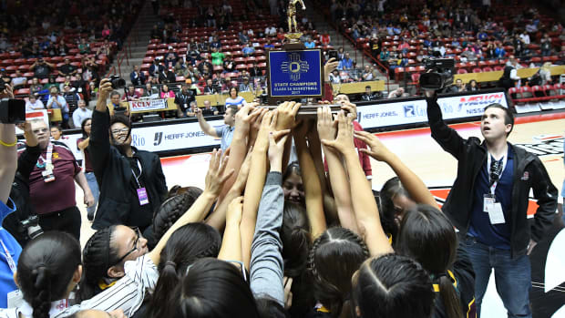 Holding up the trophy - In the heat of the game - The second-ranked high-school Shiprock Lady Chieftains won the championship 4A blue trophy for the sixth time by defeating the number one-ranked Hope Christian Lady Huskies. Moji Sports Photography