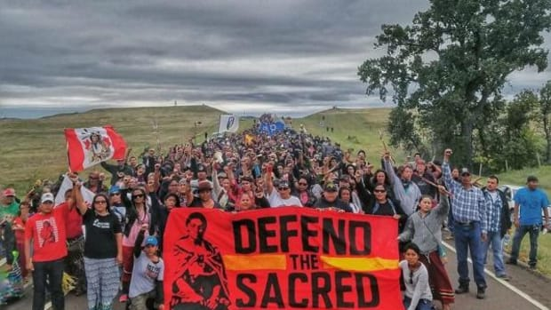 Following the destruction of Lakota burial grounds and sacred sites by Dakota Access pipeline workers, more than 500 water protectors gathered to pray. More than 8,000 people representing 180 tribes have converged at the Oceti Sakowin Camp at Standing Rock to protect their water and sacred sites.