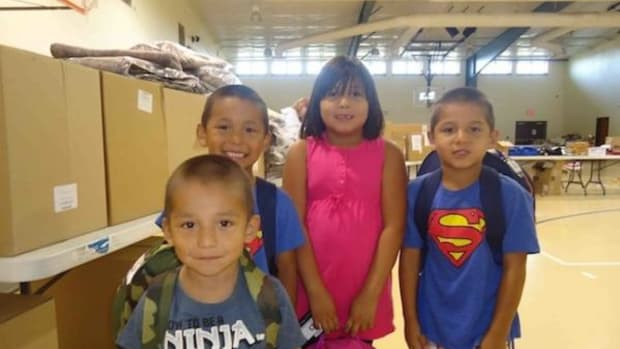 Cheyenne River children with their backpacks full of school supplies from the supply drive in 2013.
