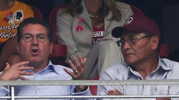 Washington football team owner Dan Snyder, left, and Navajo Nation President Ben Shelly sit in a suite during a game at the University of Phoenix Stadium in October 2014.