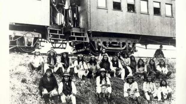 Apache en route to Florida as prisoners of war in September 1886. This picture was taken near San Antonio, Texas.
