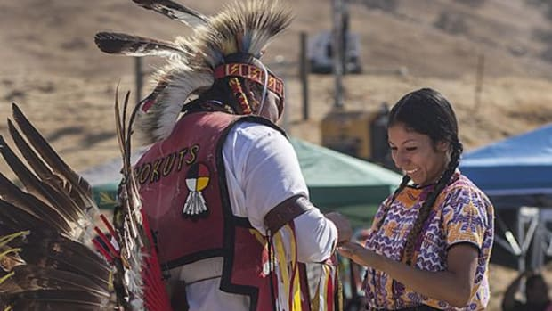 Northern traditional dancer and powwow headman Johnny Nieto, Tule River Yokut, proposes to his girlfriend Yendi Juarez during The Tule River Band of Yokuts Presents the 2014 Tule River Pow-Wow.