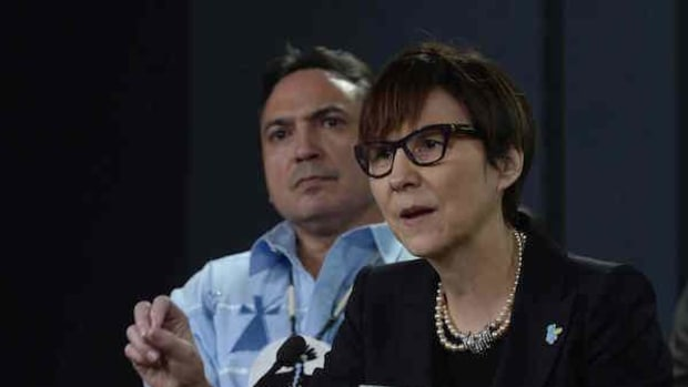 Assembly of First Nations National Chief Perry Bellegarde looks on as First Nations Child and Family Caring Society Caring Society Executive Director Cindy Blackstock speaks about the Canadian Human Rights Tribunal regarding discrimination against First Nations children in care during a news conference in Ottawa, Tuesday, January 26, 2016.