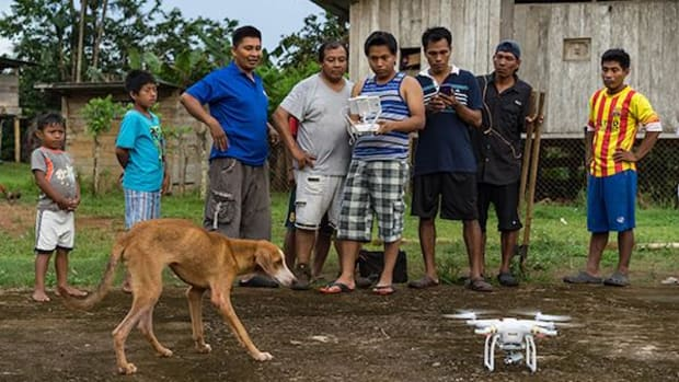Carlos Doviaza, Project Specialist with the National Coordinator of Panama's Indigenous People, prepares to fly a drone in the village of Rio Hondo.