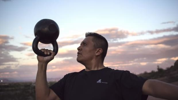 Dion Begay works out with a kettle bell - one of his favorite tools for fitness - in Arizona.