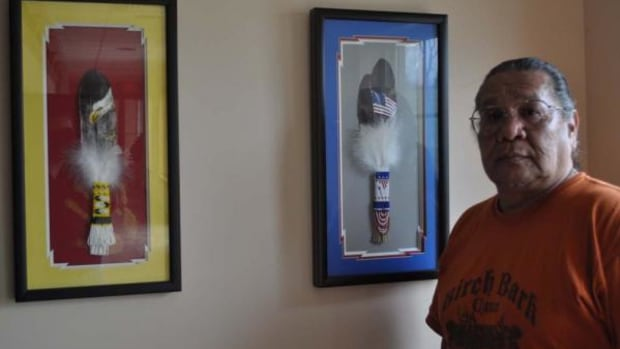Shadow box feather paintings by Ambrose Peshlakai. On right he made for his Uncle who was a Navajo Code Talker, Francis Thompson. On Left, an eagle feather painting with original beadwork handprint on the background - his signature on all his feather paintings.
