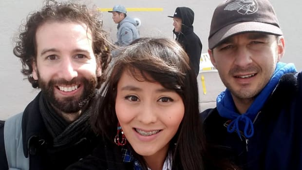 """Artist Luke Turner, Red Nation council member Melissa Tso and Actor Shia LaBeouf at the """"He Will Not Divide Us"""" art installation in Albuquerque. Photo Jason Asenap"""