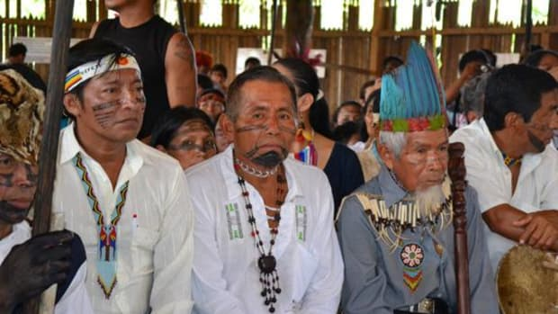 Members of the Kichwa Community sitting in the court room as the Inter-American Court of Human Rights gave its ruling in their favor against the Ecuadorian government in regards to violating its rights to communal property and cultural identity.