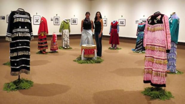 Artists Leanna Marshall, left, and Celeste Pedri-Spade pose amid the Thunder Bay Art Gallery exhibit that represents two years of work bringing family and community histories into their art. The exhibit continues into September.