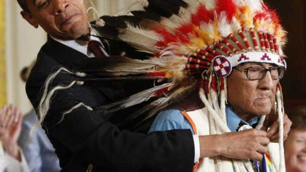 President Barack Obama presents the Presidential Medal of Freedom to Joseph Medicine Crow at the White House in August 2009. Reuters