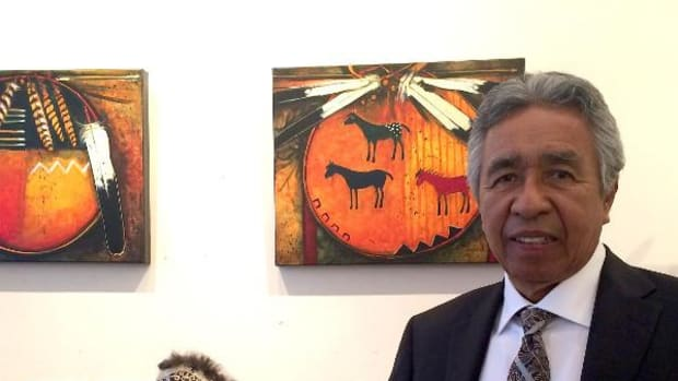 Kevin Red Star with his work at the Orenda Gallery in Paris. Photo by Dominique Godreche.