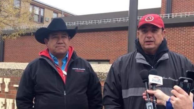 Cheyenne River Sioux Chairman Harold Frazier, left, and Standing Rock Sioux Chairman David Archambault II, in Bismarck, denounce the military violence used to clear the Treaty Camp.