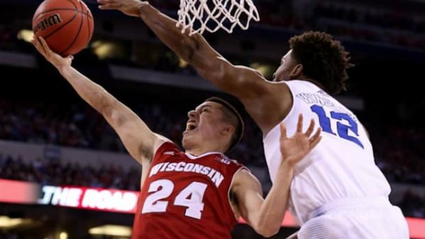 Bronson Koenig, No. 24, drives for two against Duke's Justise Winslow at the NCAA Championships on Monday, April 6, 2015.