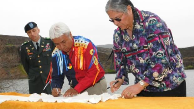 During an earlier term as chairman, Dr. Marchand signed the Columbia River Basin Fish Accords on behalf of the Confederated Tribes of the Colville Reservation. From left to right: Col. Steven Miles, Northwestern Division commander, U.S. Army Corps of Engineers; Dr. Marchand; and Ralph Sampson, at that time chairman of the Yakama Nation Tribal Council. Columbia Hills State Park, Washington; May 8, 2008.