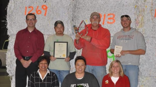The Choctaw Nation's Recycling Center received awards for the tribe's environmental preservation efforts. The staff members pictured: (back row from left) Lance Clinton, Justin Tillery, Terry Garner, Chris Stover, and Cyndi Houser (kneeling), Tamera Couch and Tracy Horst. (Courtesy of Choctaw Nation)