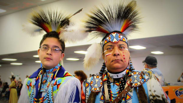 A father and son stand strong at the Richmond Pow Wow: Photo - Vincent Schilling - Pow Wow Planner