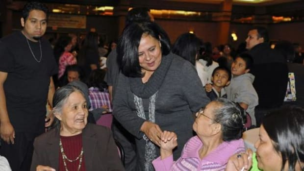Chief Anderson speaking with elders at the Choctaw community Thanksgiving feast, November 2011.