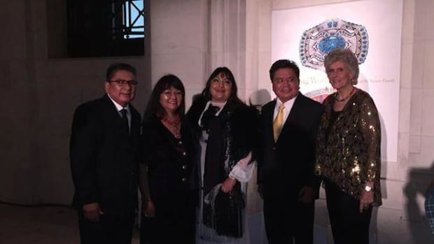Raymond, Colina and Lee Yazzie with fashion and textile designer Patricia Michaels (center) and Glittering World exhibit curator Lois Dubin (right) at the 20th anniversary gala of the National Museum of the American Indian (NMAI) in New York City.