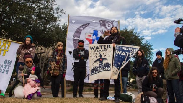 Austin-based indigenous-rights activist Tane Ward addresses a group of water protectors who came from across Texas on Thursday January 26 to stand against Energy Transfer Partners CEO Kelcy Warren at a Texas Parks and Wildlife Commission meeting. Commission member Warren didn't show.