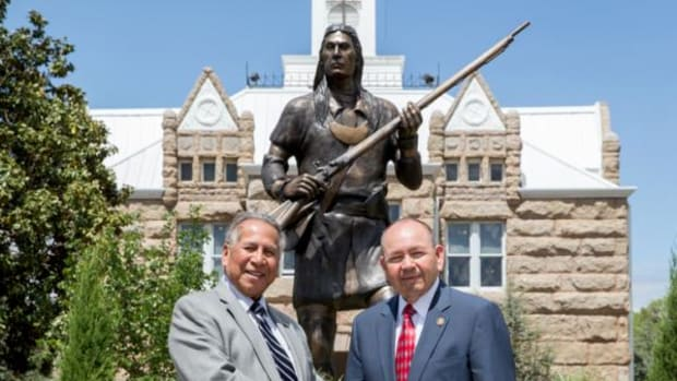 Internationally renowned artist and former Seminole Nation Principal Chief Enoch Kelly Haney, left, and Chickasaw Nation Governor Bill Anoatubby pose in front of Haney's vision of famed Chickasaw leader Piominko. The statue was formally dedicated Monday, April 28, in Tishomingo, Oklahoma, on the grounds of the Chickasaw Nation Capitol.